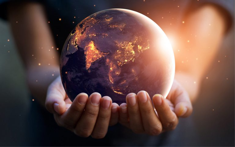 A globe on hands